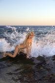 Blond Woman in Bikini on Rocks — Stock Photo