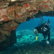 Stock Photo: Diver exploring LavArch in Hawaii