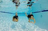 Smiling Girls Swimming Underwater — Stock Photo