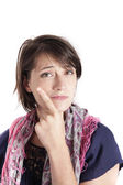 Humourous portrait ogf a young woman with finger on her mouth — Stock Photo