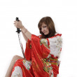 French young girl geisha in red silk kimono with japanese sword — Stock Photo