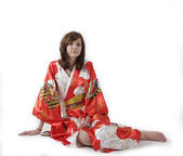French young girl geisha in red silk kimono — Stock Photo