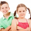 Two children standing over white background — Stock Photo