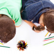 Top view of two children drawing with colorful crayons, isolated — Stock Photo