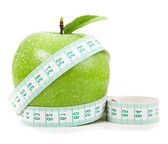 Fresh apple with measuring tape. isolated over white background — Stock Photo