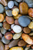 Abstract background with round peeble stones — Stock Photo
