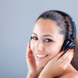 Royalty-Free Stock Photo: Smiling beautiful woman listening to music