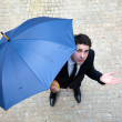 Young business man checking if it's raining — Stock fotografie