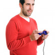 Excited young man playing video games. Isolated on white — Stock Photo #12940246