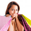 Closeup portrait of beautiful young woman holding shopping bags over white — Stock Photo