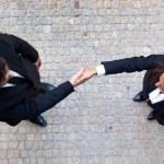 Business handshake between businessman and businesswoman — Stock Photo
