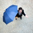 Young business man checking if it&#039;s raining - Stock Photo