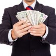 Business man holding money on white background - Stock Photo