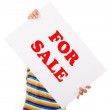 Young casual man holding sale sign against white background - Stock Photo