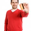Happy smiling young man showing credit card isolated on white background — Stock Photo #13649901