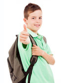 Happy school boy giving thumbs up, isolated on white background — Stock Photo
