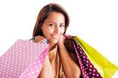 Closeup portrait schöne junge frau, die holding einkaufstaschen weiß — Stockfoto
