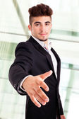 Business man giving hand for handshake — Stock Photo