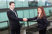 Businesspeople shaking hands at modern office — Stock Photo