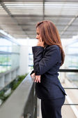 Young business woman talking on cell phone at the office — Stock Photo