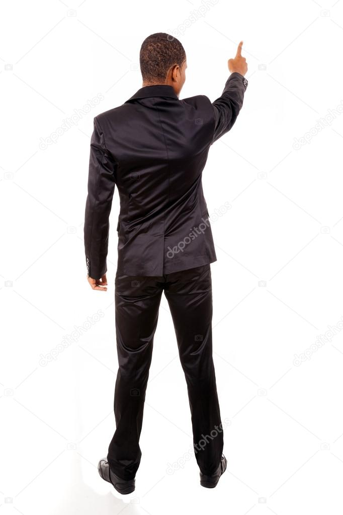 Full length of a African business man pointing at copyspace isolated over white background  — Stock Photo #13648247