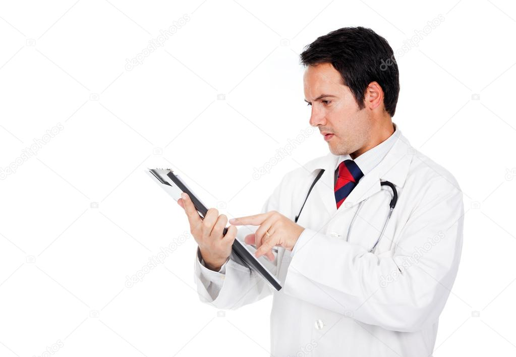 Young doctor consulting his clipboard with copyspace, isolated over white background  — Stock Photo #13648595
