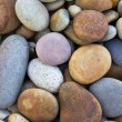 Stock Photo: abstract background with round peeble stones