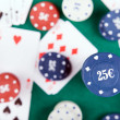 Poker chips and cards on a green felt — Stock Photo