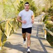 Young man running at the park — Stockfoto