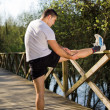 Young man stretching at the park — Stock Photo