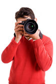 Professional photographer with camera on white background — Stock Photo