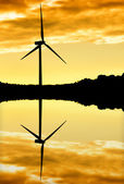 Windmill silhouette at sunset — Stock Photo