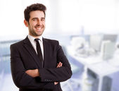 A handsome young business man at the office — Stock Photo