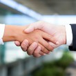 Image of business handshake after signing new contract at the of — Stock Photo