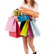 Shopaholic young woman holding gifts and shooping bags on white — Stock Photo #14403607