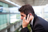 Close-up of a successful young business man talking on cell phon — Stock Photo