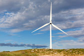 White wind turbine in the top of the mountain generating electri — Foto Stock