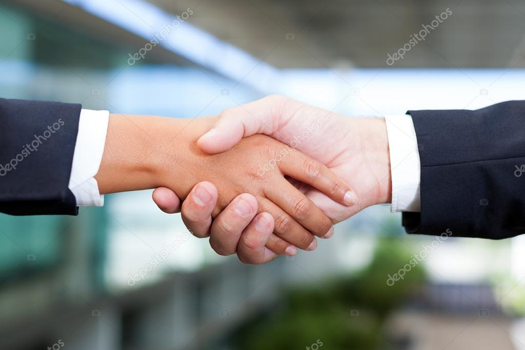 Image of business handshake after signing new contract at the office — Stock Photo #14403307