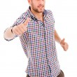 Young casual man thumb up in a white background — Stock Photo