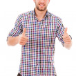 Young casual man thumb up in a white background — Stock Photo #15872057