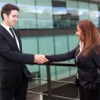 Handshake between businessman and businesswoman at modern office — Stock Photo