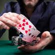 Poker player throwing cards on black background — Stock Photo #15873685