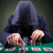 Poker player on black background — Foto de Stock