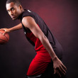 Portrait of a young male basketball player against black backgr — Stock Photo #15873995