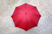 Red umbrella outdoors — Stock Photo