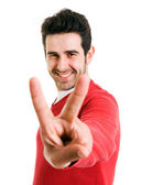 白い背景の若者勝者ジェスチャの笑みを浮かべてください。 — ストック写真