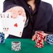 Poker player isolated on white background - Stok fotoğraf