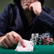 Poker player on black background — Stock Photo