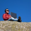 Young man working outdoors with laptop — Stock Photo #19934745