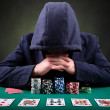 Stock Photo: Poker player on black background